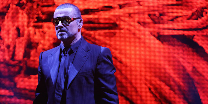 LONDON, ENGLAND - OCTOBER 25: (UK TABLOID NEWSPAPERS OUT) George Michael performs onstage for his Symphonica: The Orchestral Tour at The Royal Albert Hall on October 25, 2011 in London, United Kingdom. (Photo by Dave Hogan/Getty Images)